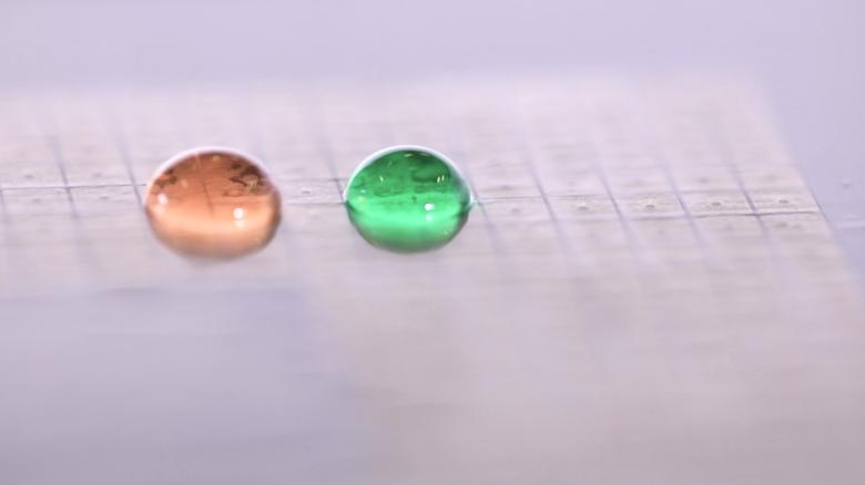 Merging Droplet: Two droplets before merging.
