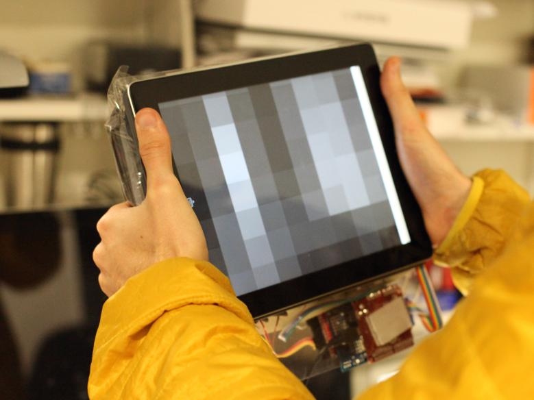 Behind-the-Tablet Jamming Interface: The Behind-the-Tablet Jamming Interface enables malleable input with varying stiffness as haptic feedback, while avoiding occlusions with on-screen content.
